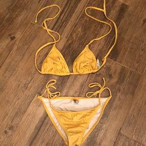 Itty bitty teeny weeny yellow polka dot bikini 👙